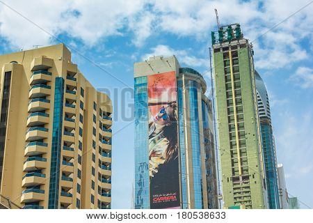 Dubai, United Arab Emirates - May 1, 2013: modern buildings with billboards and residential complex in Downtown Dubai district, important part of development in Dubai.