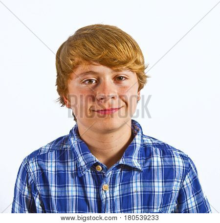 portrait of smiling smart young boy in studio