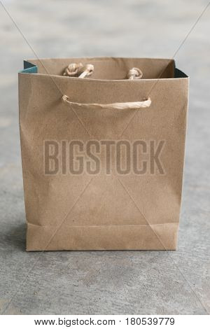 Shopping bag made from brown recycled paper concrete background add your own design or logo on concrete background