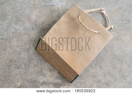Recycled paper Kraft shopping bag on concrete background