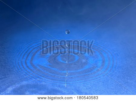 stiffened water drop falling on a water surface,In the fog
