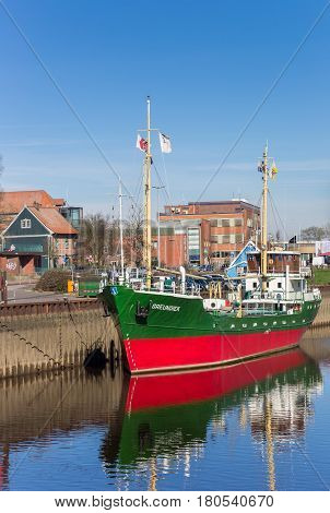 STADE, GERMANY - MARCH 27, 2017: Museum ship Greundiek, a coaster originating from 1950 in the harbor of Stade, Germany