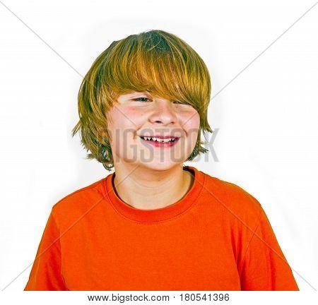 Handsome Smiling Boy In Orange Shirt