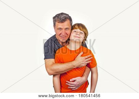 father and son hugging in studio isolated on white