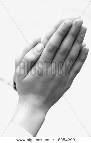 Conceptual image  showing appreciation and thankfulness - Two hands clasp together in black and white