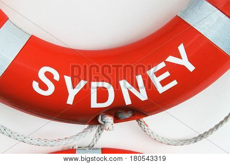 close-up of red and white lifebuoy with text Sydney