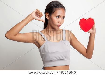 Asian Woman Thumbs Down With Red Heart.