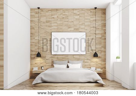 Front view of a bedroom with light wooden walls a double bed with gray bedding and a large horizontal poster hanging above it. 3d rendering mock up