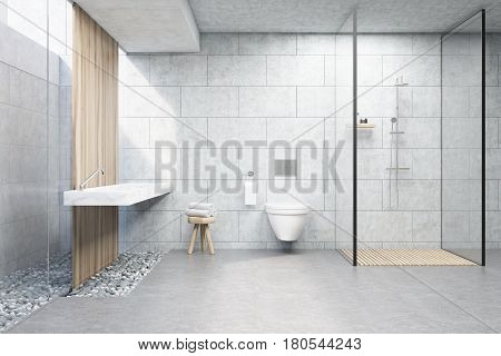 Bathroom interior with gray brick walls a shower cabin with glass wall a toilet and a double sink. 3d rendering.