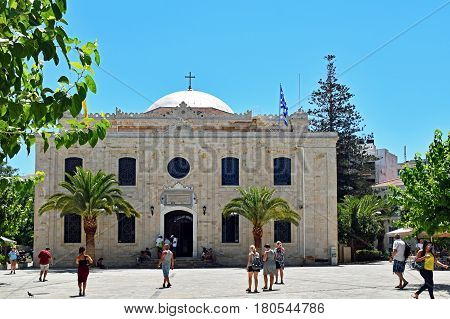 Heraklion, Greece - July 15, 2016: People waiting and walking in front of the Church of Saint Titus in Heraklion, the capital of the Mediterranean island of Crete in Greece.