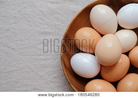 Organic Free Range Eggs In Wooden Bowl