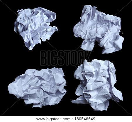 white crumpled papers isolated on black background