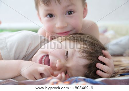 kids laughing happy children smiling portrait playing together siblings little girl and boy brother and sister toddlers having funchildhood friendship. Funny two kids faces cute and carefree