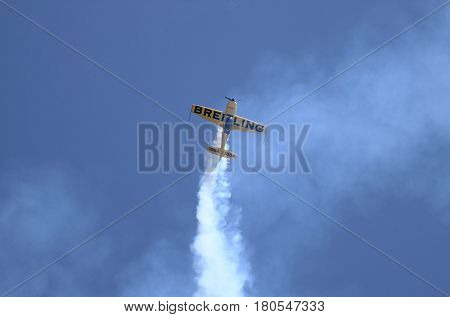 ROME - JUNE 3: The italian pilot Francesco Fornabaio performs on a Breitling Extra 300 airplane at the Rome International Air Show on June 3 2012 in Rome Italy