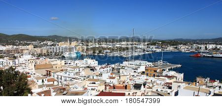 IBIZA TOWN, SPAIN - October 17 2012: Panoramic view of Ibiza town with ferries moored in the harbour