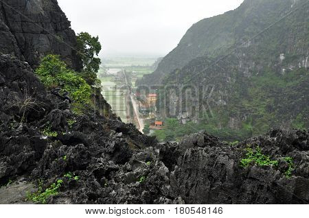 Panorama View Of Rice Fields And Limestone Rocks And From Hang Mua Temple Viewpoint