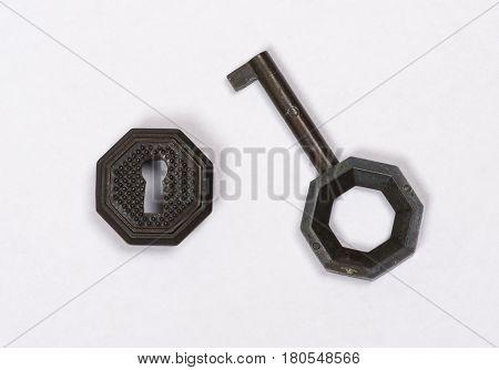key hole and key closeup on white background