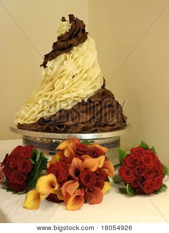Unique wedding cake made out of swirls of milk and white chocolate profiteroles
