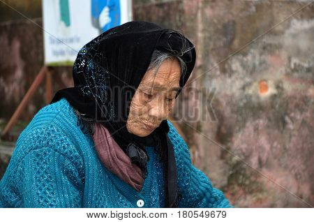 Portrait Of An Elderly Vietnamese Woman With A Scarf