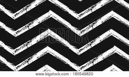 Hand drawn vector abstract rough geometric monochrome seamless zig zag chevron pattern in black and white colors.Hand made grunge brush painted texture.Scandinavian concept design for fashionfabric