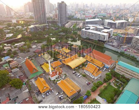 Beautiful Evening Aerial View of Residential District and Buddhist Temple of Bangkok' suburbs, Thailand