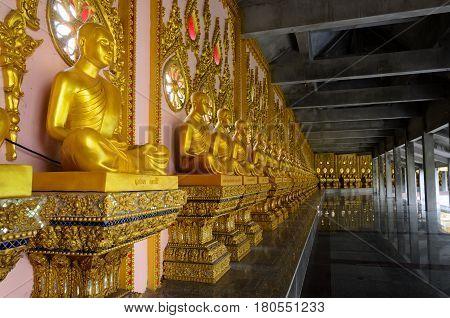 wall of neat asian golden sculpture monks