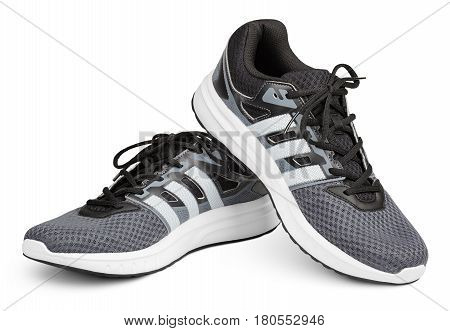 Pair of new unbranded gray sport running shoes sneakers or trainers isolated on white background with clipping path