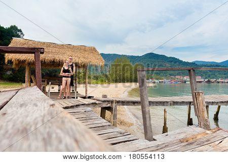 Young beautiful couple on honeymoon. Summer landscape on tropical koh Chang island on Bang Bao beach.