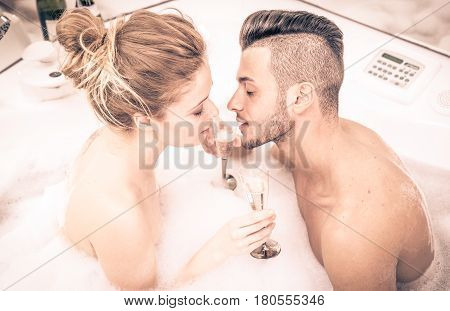 Couple in the jacuzzi sharing romantic moments