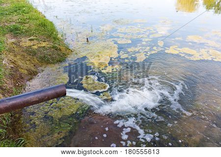 From The Pipe Water Flows Into The River, Sea. Environmental Pollution.