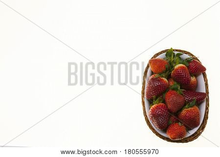 Strawberry background, basket with ripe strawberries close-up on white background