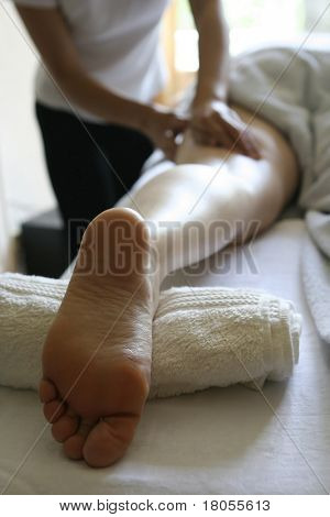 A woman receiving a holistic massage treatment