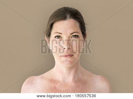 Woman solo shirtless studio portrait