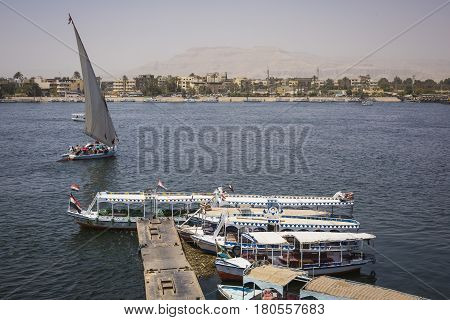 Wooden boats carrying passengers docked along the Nile River in Aswan Egypt North Africa
