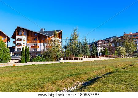 Bansko, Bulgaria summer or autumn view with trees, mountains landscape and houses