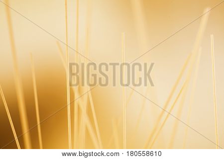 Background macro composition of uncooked dried spaghetti