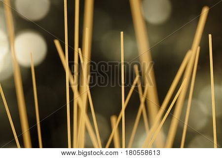 Raw uncooked spaghetti chaotically standing upright