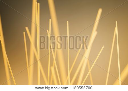 Raw uncooked spaghetti standing upright chaotically