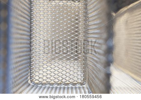 Abstract closeup of the mesh of a metal cage