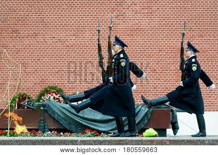 MOSCOW - APRIL 28, 2016: Changing of the Honor Guard Ceremony at the Tomb of the Unknown Soldier at the Kremlin Wall. The Eternal Flame burns in memory of the millions of Soviet soldiers who fell in the struggle against Nazism.
