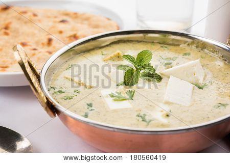 methi malai paneer or Creamy Fenugreek & Paneer Curry, popular north indian recipe prepared using milk cream, methi and paneer or cottage cheese, served with roti/paratha, selective focus