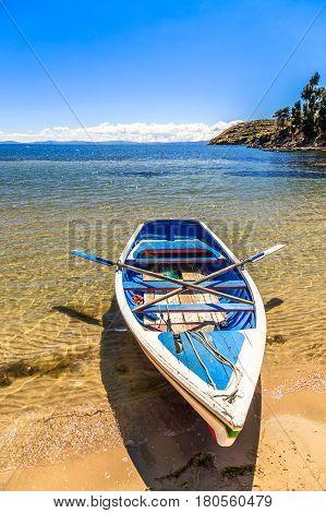 Lone Boat, Blue Water And Coast Of Titicaca, Island Of The Sun, Bolivia, South America