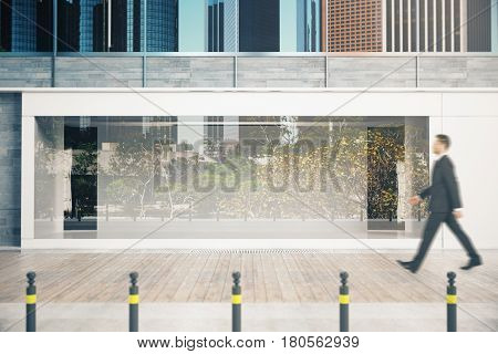 Man Passing Shopfront