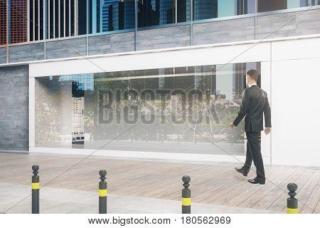 Man Passing Storefront