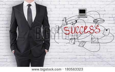Young businessman on white birck background with business sketch. Success concept