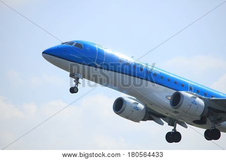 Amsterdam the Netherlands - April 2nd 2017: PH-EZF KLM Cityhopper Embraer ERJ-190STD takeoff from Polderbaan runway Amsterdam Airport Schiphol