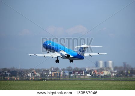 Amsterdam the Netherlands - April 2nd 2017: PH-KZP KLM Cityhopper Fokker F70 takeoff from Polderbaan runway Amsterdam Airport Schiphol
