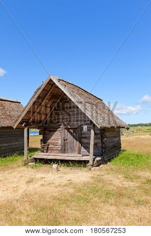 RIGA LATVIA - JUNE 13 2016: Net hut (circa 1920) of Gerbumi fishing village of Kurzeme ethnic group. Exhibited in Ethnographic Open-Air Museum of Latvia since 1984