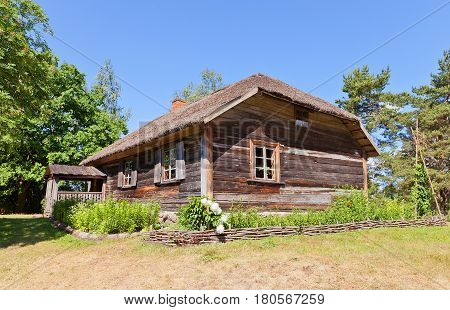 RIGA LATVIA - JUNE 13 2016: Dwelling house (circa 1840s) of fishing village of Kurzeme ethnic group. Exhibited in Ethnographic Open-Air Museum of Latvia since 1983