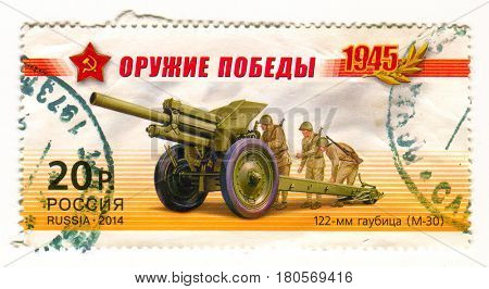 GOMEL, BELARUS, APRIL 5, 2017. Stamp printed in Russia shows image of  The 122 mm howitzer M1938 (M-30) was a Soviet 121.92 mm (4.8 inch) howitzer, circa 2014.